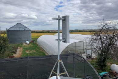 Antenna on roof of greenhouse.