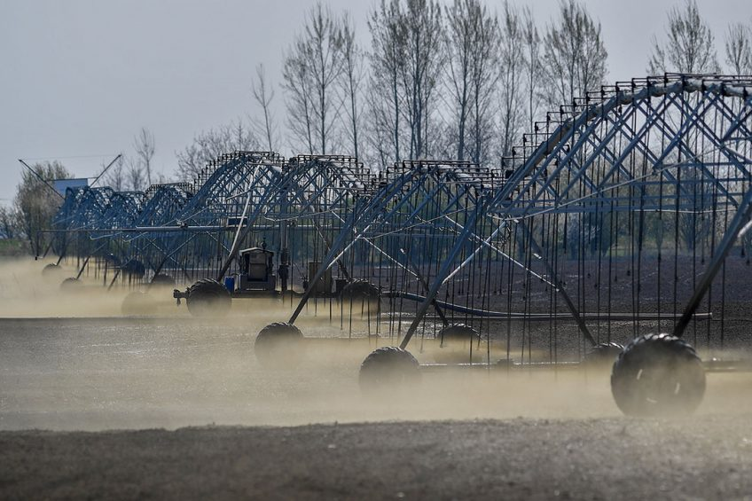 epa07484840 Irrigation system at work on a dry and dusty plough field near Hajduszovat, Hungary, 04 April 2019. According to the Hungarian Chamber of Agriculture (HCA) the drought may cause hundreds of billions of income loss to Hungarian farmers.  EPA/Zsolt Czegledi HUNGARY OUT