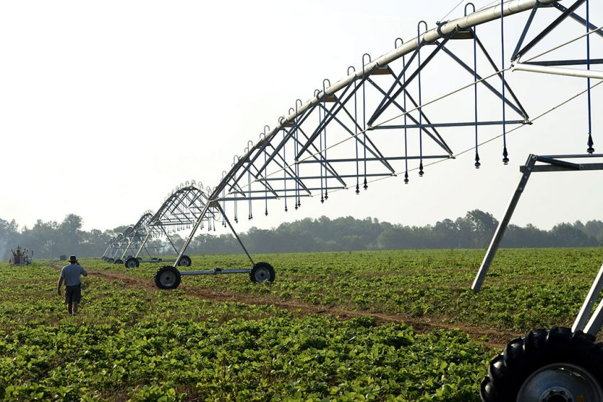 epa03317329 Blake Reid with Reid Brothers Irrigation & Equipment Company inspects a soon-to-be operational center pivot irrigation system installation in a soybean field in Elko, Georgia, USA, 25 July 2012. Many areas of central Georgia are in a state of extreme to exceptional drought conditions, according to the National Climatic Data Center. Reid said his business has increased 50 percent with the ongoing drought.  EPA/ERIK S LESSER