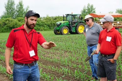 Ben Rosser, a corn specialist with Ontario s provincial agriculture ministry, discussing tillage style and nutrient management in corn with grain farmers during a University of Guelph management seminar in July 2019.