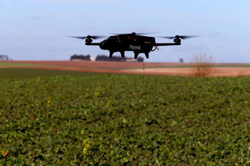 """A drone from Axe Environnement, which supplies tools for connected agriculture, is flown over French farmer Cedric Jullien's rapeseed field to map it in order to determine the best use of phytosanitary products in Semoine (Aube) on February 16, 2018. French farmer Cedric Jullien maps his fields with the help of drone technology. """"I've been doing connected agriculture for four years,"""" he says, hoping to """"improve the viability"""" of his farm and """"retrieve a maximum amount of information"""" on the plots that compose it. / AFP PHOTO / FRANCOIS NASCIMBENI"""