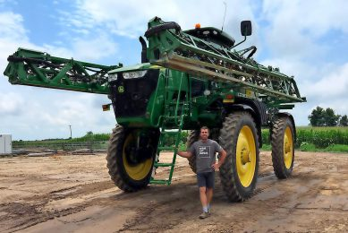Jeff Vermeersch with the sprayer - variable rate also plays an important role in their farm s crop protection regiment.