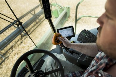 """2014-06-17 15:37:49 TO GO WITH AFP STOY by Rob LEVER, US-farm-IT-Internet-environment  Dale Blessing controls his combine harvester while harvesting barley on June 17, 2014 in Milford, Delaware. """"Precision agriculture"""" uses high-tech tools to replace seat-of-the-pants farming. GPS auto-steered tractors cut down or eliminate overplowing and overlap that wastes fuel and time. Other technologies can sense just how much water is needed in a field to cut irrigation costs. At Little Bohemia Creek, the tractor's sensors gauge the health of various segments of a field to deliver fertilizer and other chemicals more efficiently, which has an environmental benefit. AFP PHOTO/Brendan SMIALOWSKI / AFP PHOTO / BRENDAN SMIALOWSKI"""