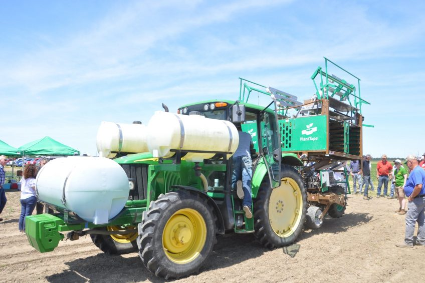 At a field demonstration day, local farmers wondered if a new-to-Canada automated transplanting machine could provide a cost-effective solution to their own labour issues.