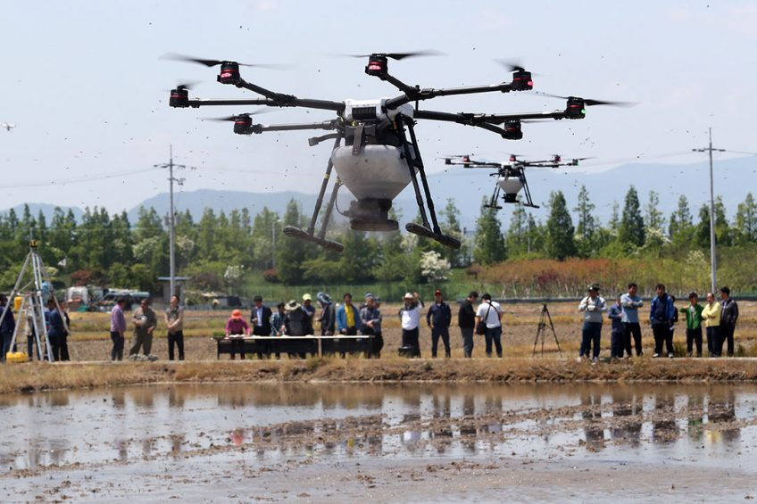 epa07552761 Drones demonstrate seeding in a rice paddy near a local agriculture technology center in Busan, South Korea, 07 May 2019. The center organized the event to introduce a farming method enabling farmers to drastically reduce their labor force.  EPA/YONHAP SOUTH KOREA OUT