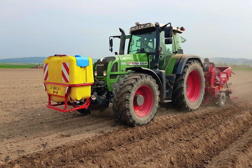 APV front tank for applying liquids while planting