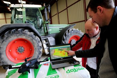 """2018-02-16 17:18:53 French farmer Cedric Jullien (L) and a technician from Axe Environnement, which supplies tools for connected agriculture, study the images obtained from a drone to determine the best use of phytosanitary products on Jullien's fields in Semoine (Aube) on February 16, 2018. French farmer Cedric Jullien maps his fields with the help of drone technology. """"I've been doing connected agriculture for four years,"""" he says, hoping to """"improve the viability"""" of his farm and """"retrieve a maximum amount of information"""" on the plots that compose it. / AFP PHOTO / FRANCOIS NASCIMBENI"""