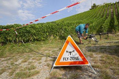 A drone pilot preparing his drone for spraying a vineyard in in Bernex near Geneva, Switzerland. - Photo: EPA