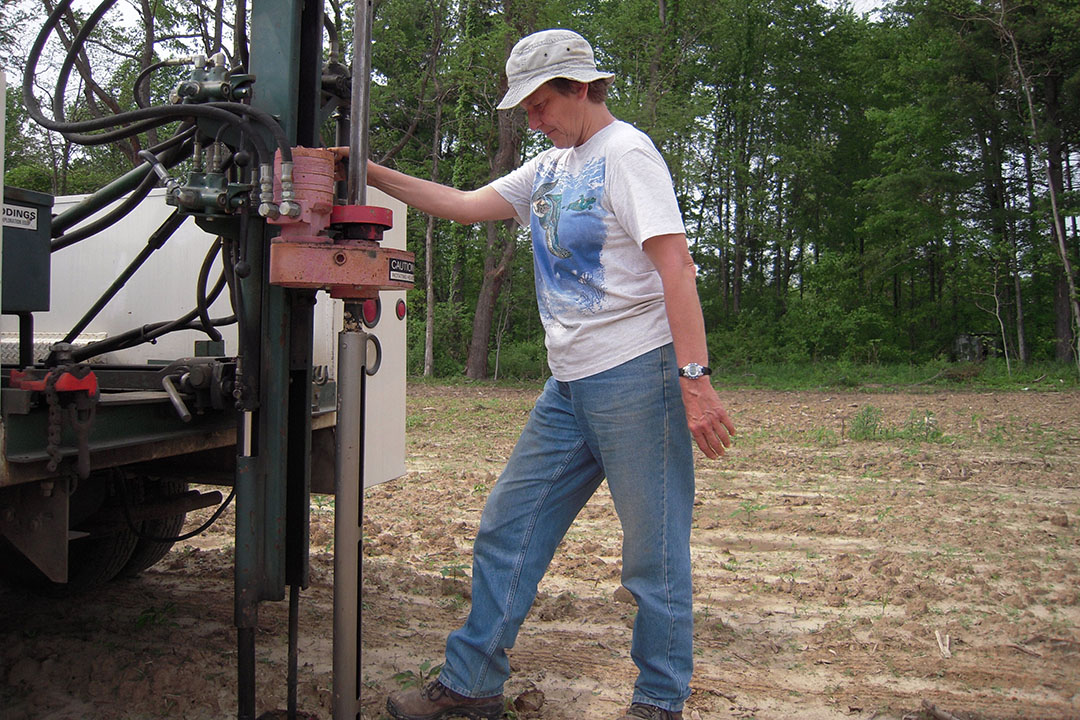 Eileen Kladivko collects soil samples using a hydraulic probe truck in the study fields that have been researched for more than 30 years to help farmers understand their farm management options. - Photo: Eileen Kladivko